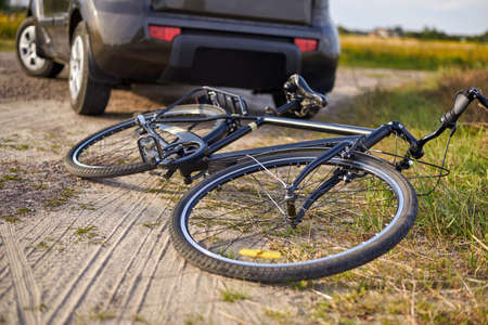 Photo of car and bicycle on the road, the concept of road accidents.