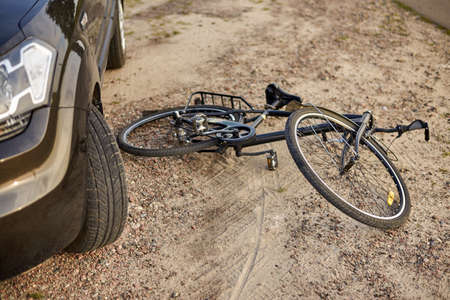 Photo of car and bicycle on the road, the concept of road accidents. Stock Photo