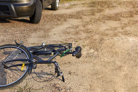 Photo of car and bicycle on the road, the concept of road accidents, copy space.