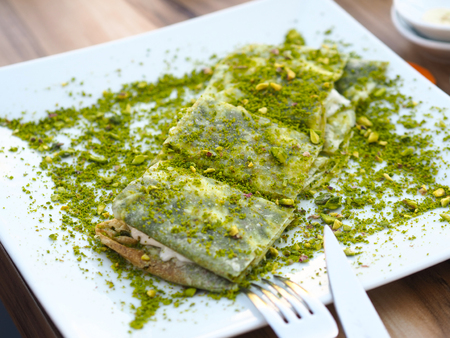 katmer dessert of Turkey Gaziantep region. Prepared with thin dough dessert with ice cream and green pistachio. Reklamní fotografie