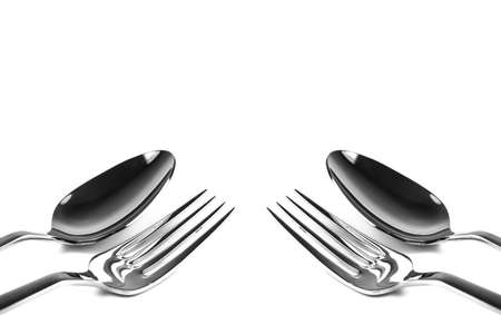 Fork and spoon on white ground