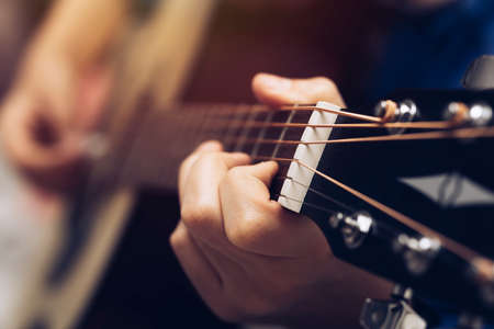 Close-up hands and tuning of the guitar player