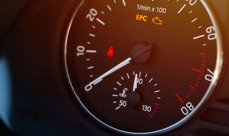 Temperature, engine revolutions and warning lights on the vehicle display