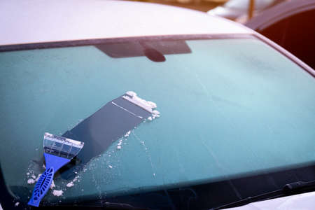 Cleaning with frozen windshield and ice scraper