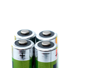 four battery plus poles and isolated background with white