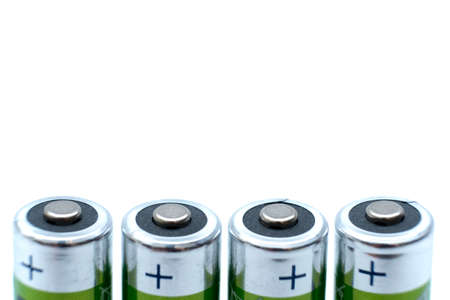 four AA batteries plus poles close-up and white background