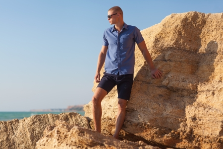 fashion man on the beach  photo