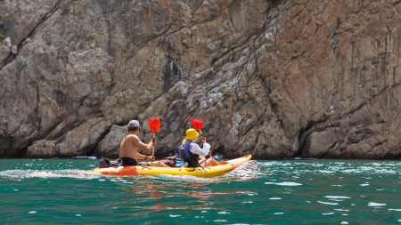 Kayak  People kayaking in the ocean photo
