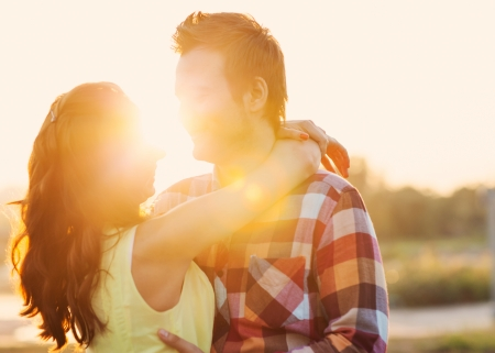 Young couple in love outdoor at sunset