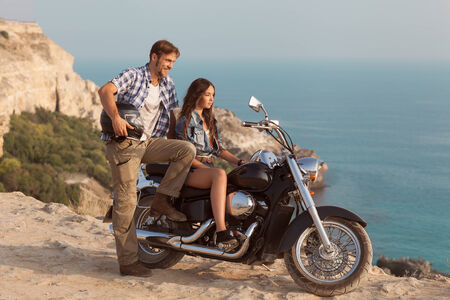 Biker man and girl photo