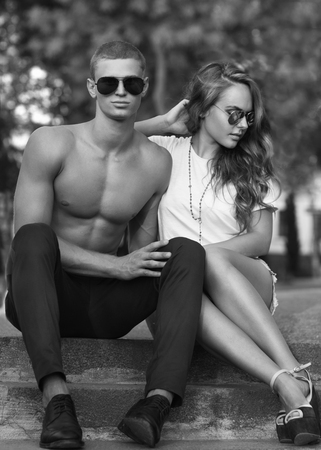 Sexy man and woman doing a fashion photo shoot in sunset photo