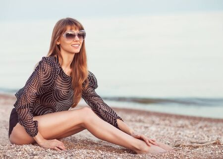 Beautiful woman sunbathing at the seaside photo