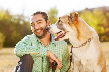 summer dog: Man and central Asian shepherd Stock Photo