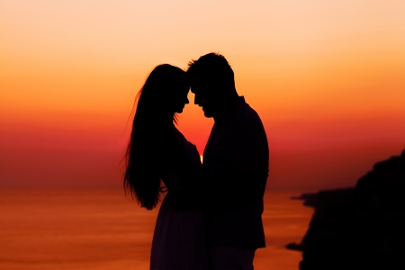 silhouette of a loving couple at sunset photo