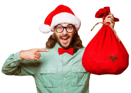 Santa Claus with the bag of the presents Stock Photo - 23379055