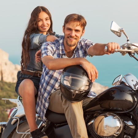 fashion couple sitting on a motorcycle photo
