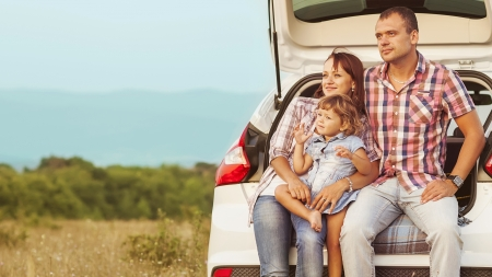 family in the mountains by car