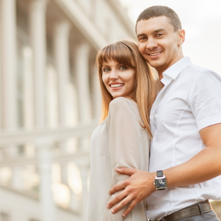 Couple happiness fun. Interracial young couple embracing laughing on date. photo