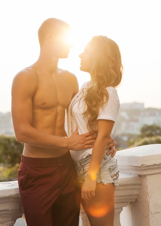 Young couple in love outdoor. Romantic young couple enjoying sun, sunshine, romance and love. photo
