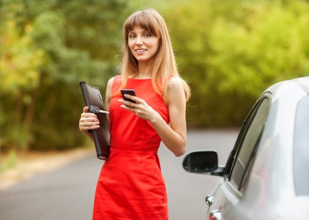 business woman standing near car photo