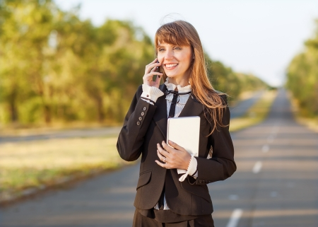 businesswoman specifies the transaction by phone photo