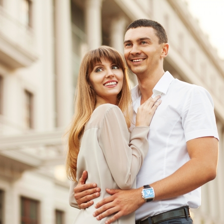 Couple happiness fun. Interracial young couple embracing laughing on date.
