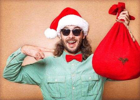 Guy holding a gift and emotionally happy Christmas photo