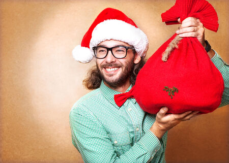 hipster in Santa Claus clothes with the socks of the presents Stock Photo - 24258065