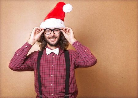 handsome man dressed as Santa Claus. emotional portrait, hipster Style. Stock Photo - 24258076
