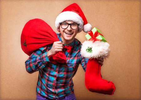 Guy holding a gift and emotionally happy Christmas Stock Photo - 24258087