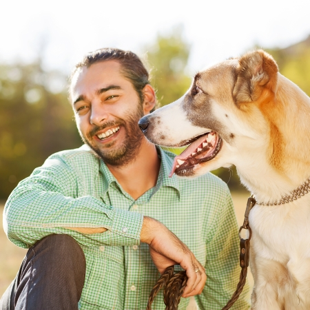 owners: Man and central Asian shepherd Stock Photo