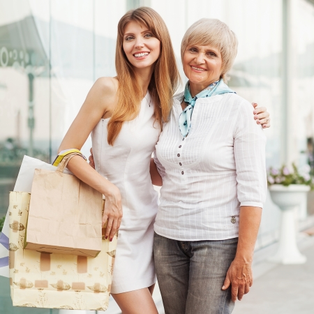 Adult mother and daughter after shopping photo