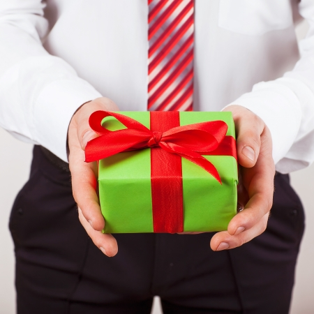 Businessman present gift box isolated over white background, series photo photo