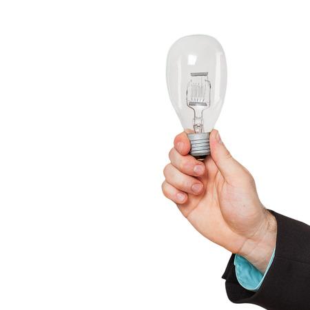 Businessman hand shows Light bulb photo