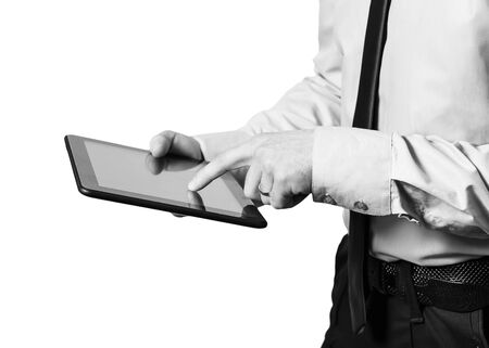 businessman hands holding a tablet touch computer gadget with isolated screen photo