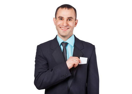 Part of body of business man who takes out business card from the pocket of business suit, copyspace photo