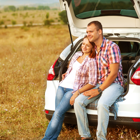 couple in the mountains by car photo