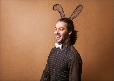 Fashion guy in bunny ears photo