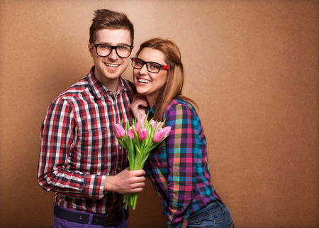 Young couple in love  holding a bouquet of tulips. The concept of Valentine's Day photo