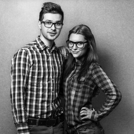 couple of guys dressed in clothes hipsters are in the studio  photo
