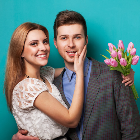 Beautiful couple in love with flowers tulips Valentine photo