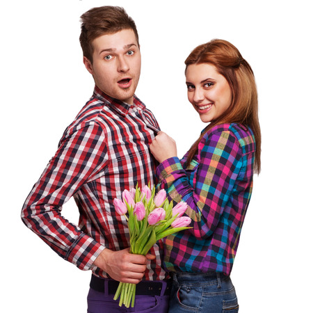 Young couple in love holding a bouquet of tulips  The concept of Valentine photo
