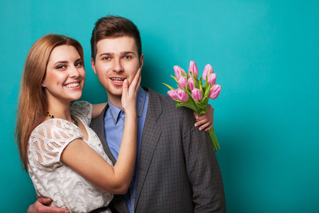 Beautiful couple in love with flowers tulips Valentine