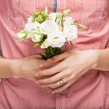 Hands holding a Wedding bouquet close-up  photo