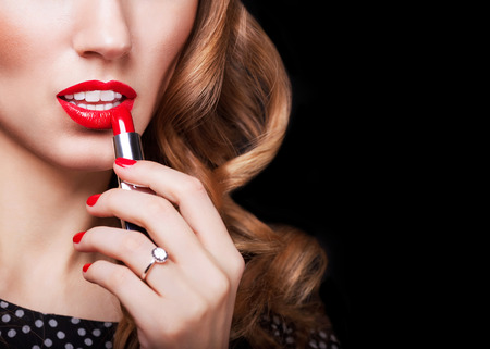 bright lipstick: Glamour Fashion Woman Portrait paints lips with lipstick