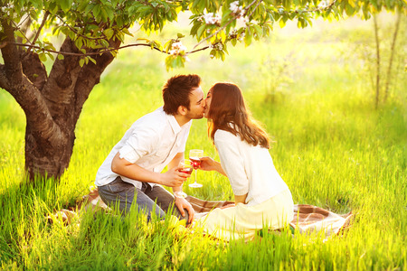 love kissing: Couple in love kissing in nature are holding wine glasses