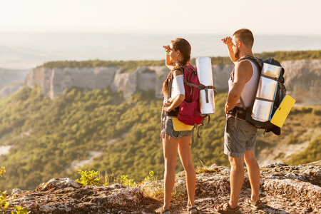 Hikers - people hiking, man looking at mountain nature landscape scenic with woman. Stock Photo