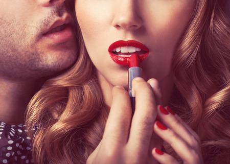 Beautiful portrait of young man lips red lipstick Stock Photo