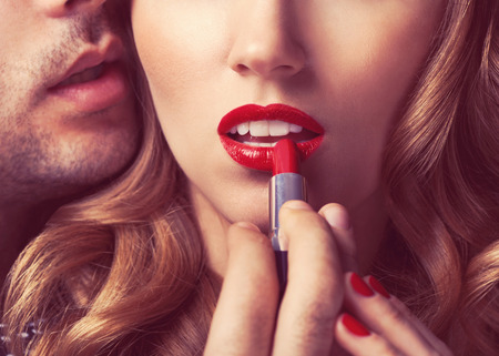 Beautiful portrait of young man lips red lipstick photo