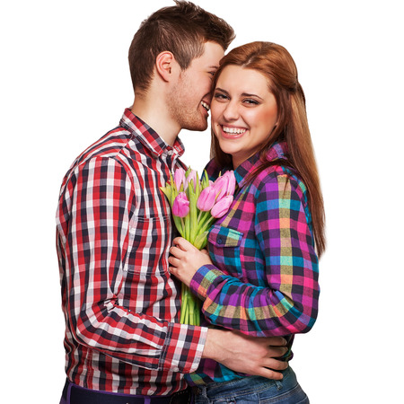 Young couple in love holding a bouquet of tulips. The concept of Valentines Day photo